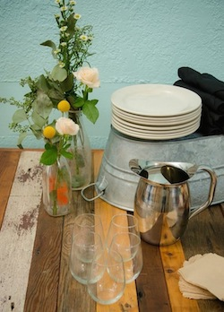 Use wild flowers for decoration and reusable table-ware to reduce waste.