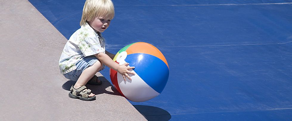 Boy by pool with ball.jpg
