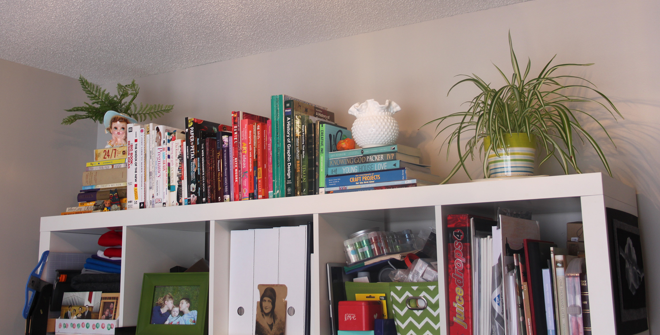 I did get the top of the shelf done which I love! I mean, who doesn't love books arranged by spine color?