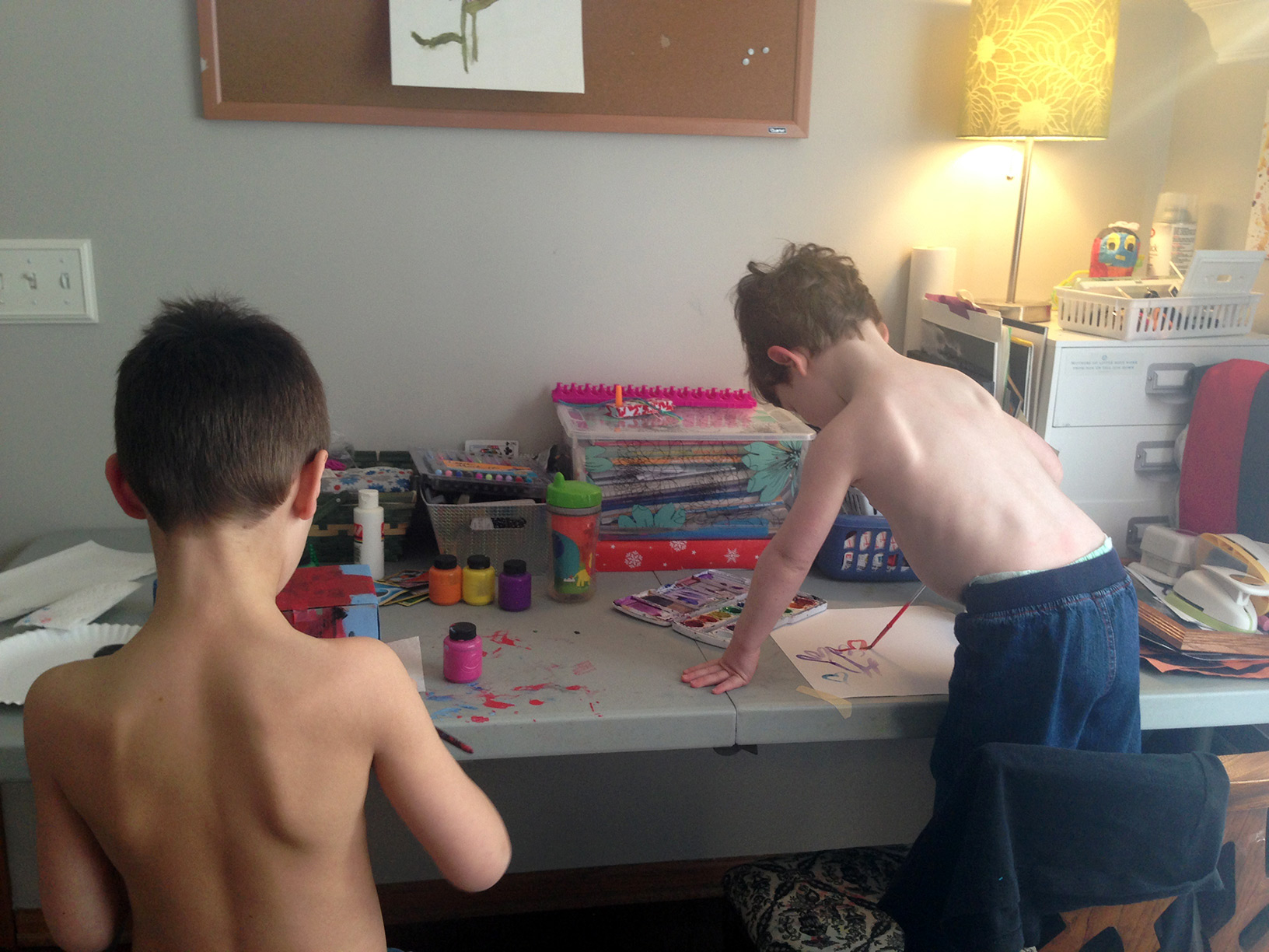 The brother's painting. Of course, little brother had to take his shirt off like big brother.