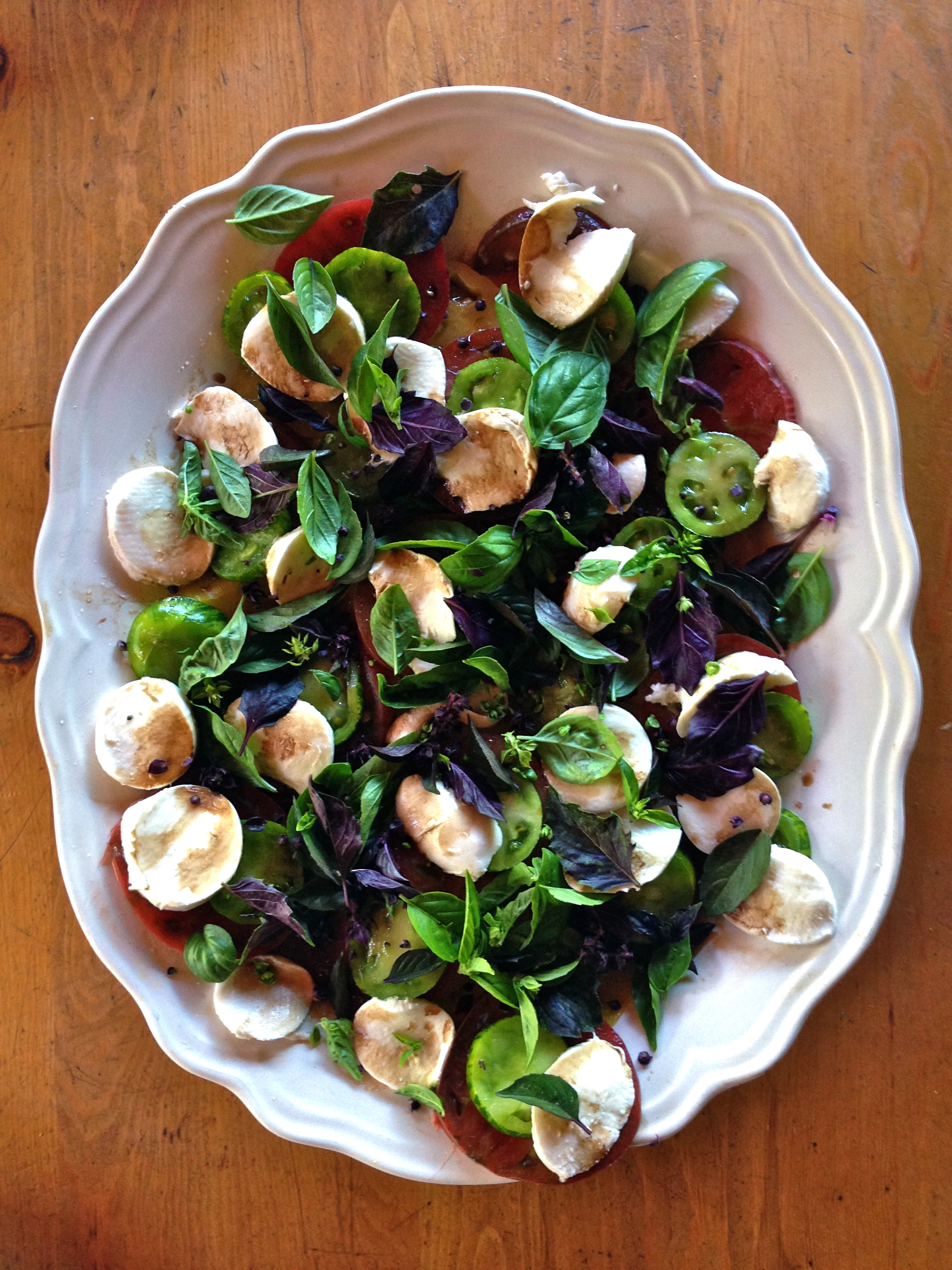 Dea's Insalata Caprese with zebra green+ purple cherokee tomatoes with bocconcini mozzarella, licorice basil, balsamic + olive oil