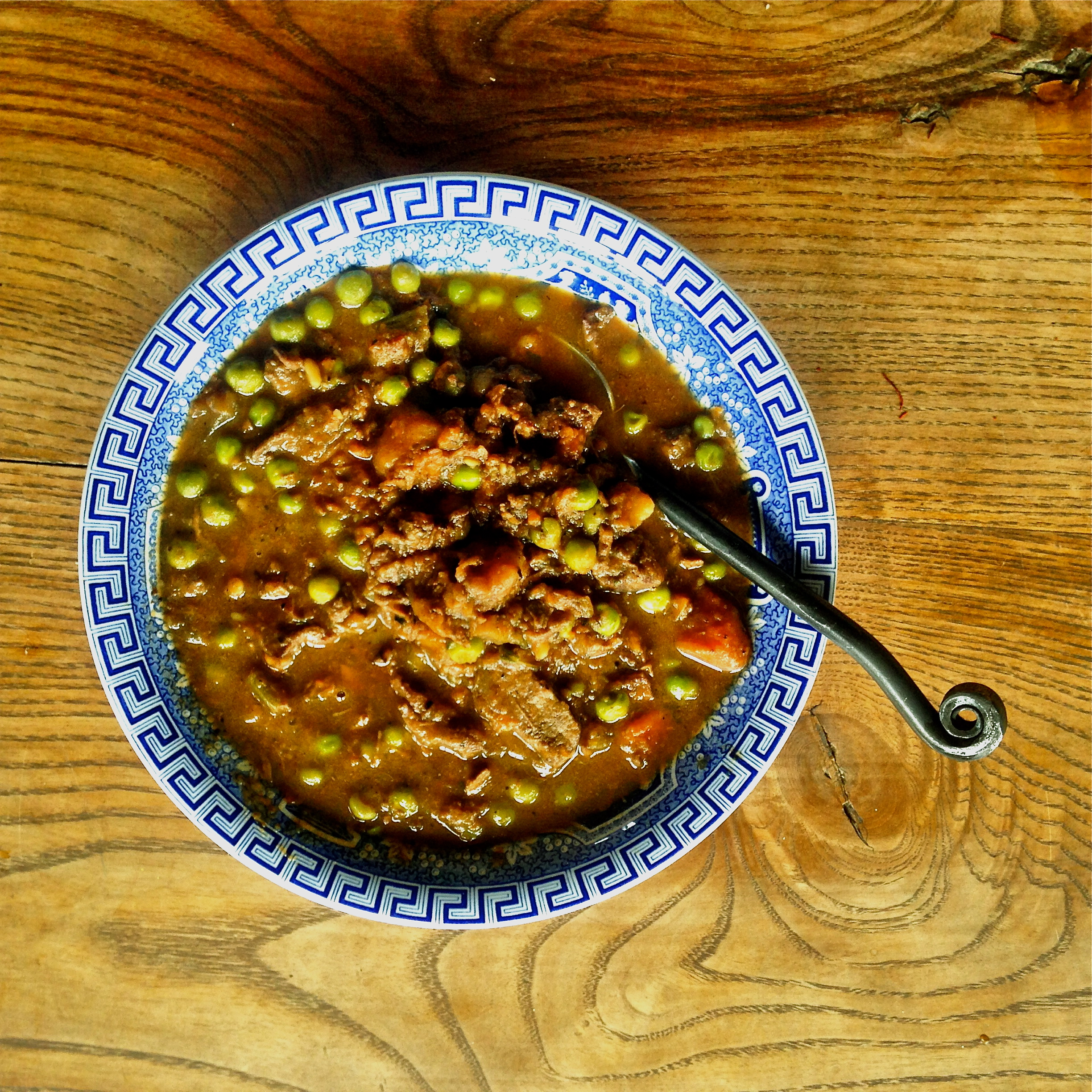 Venison Stew with mushrooms, carrots, peas and red wine.