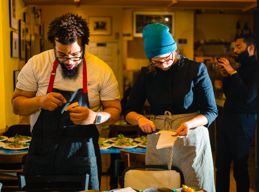 Chef Kurt Evans and Chef Katie Briggs at South Philly Barbacoa// Photo by Ted Nghiem