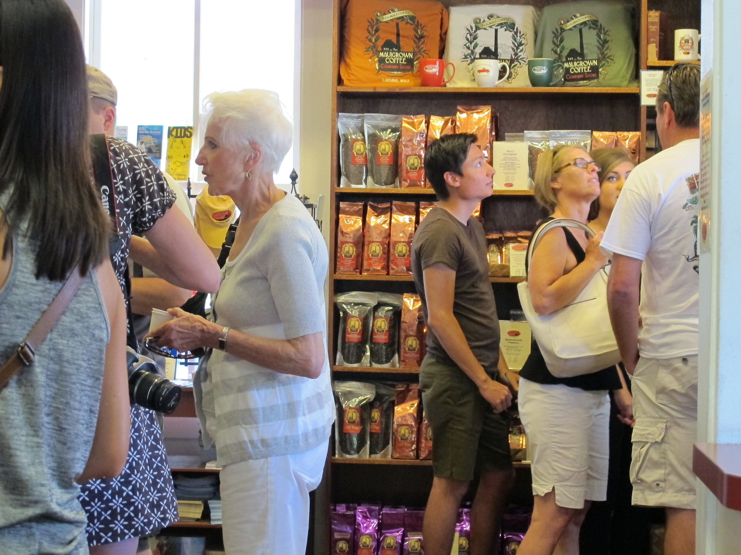 The Ka'anapali Estate Company Store sells brewed coffee, whole roasted beans, green coffee, shirts, and mugs.