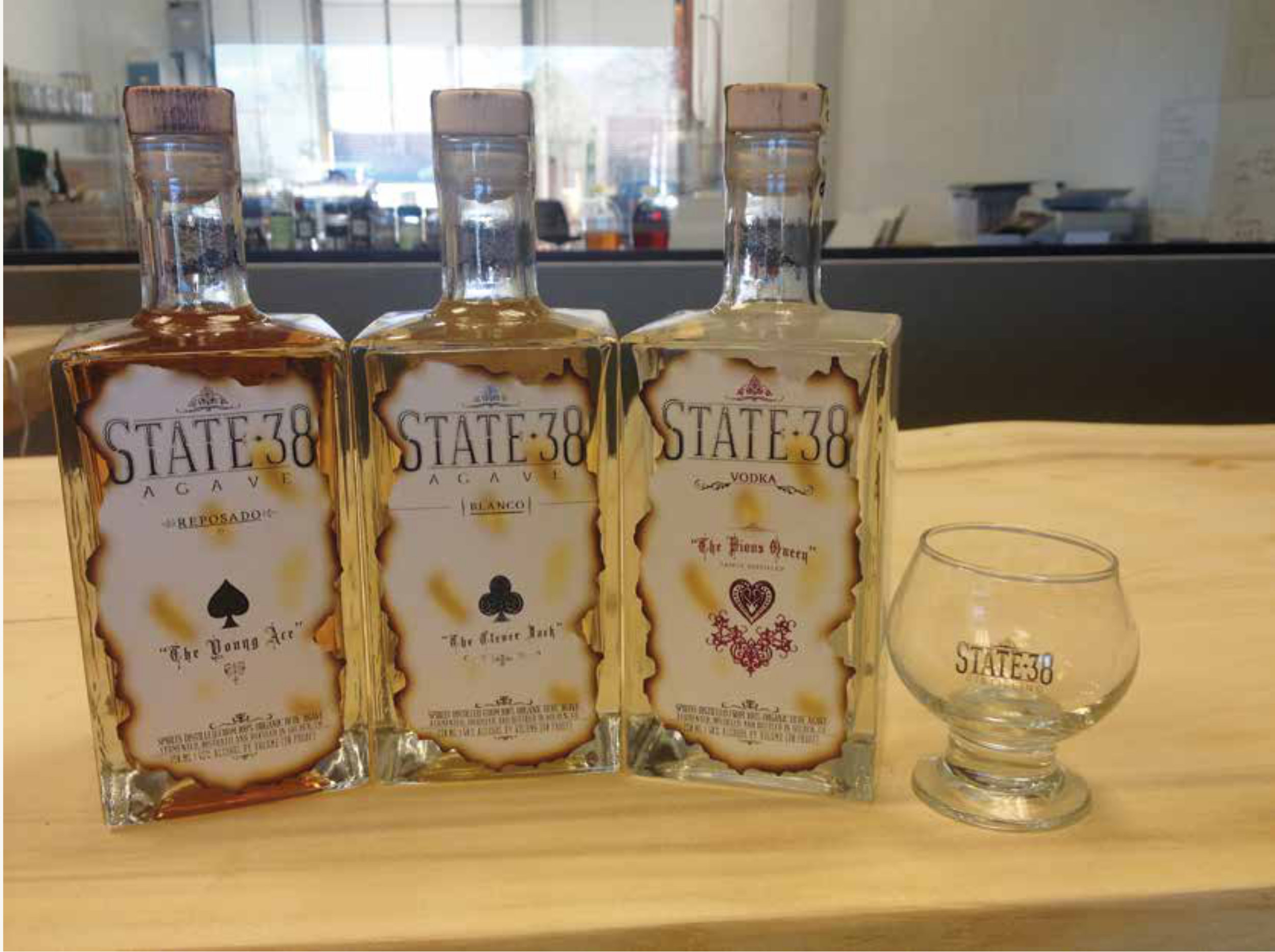 The Young Ace, reposado agave spirit, The Clever Jack blanco agave spirit and The Pious Queen vodka are part of the agave-centric spirits line distilled at State 38. The distillery also makes an agave-based gin. Photo courtesy of State 38 Distilling