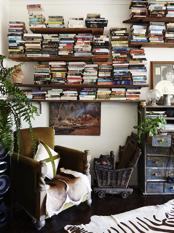 Living room. Pony Rider cushion, vintage post box filled with plants, picnic basket on wheels. Photo – Eve Wilson. Production – Lucy Feagins/The Design Files.