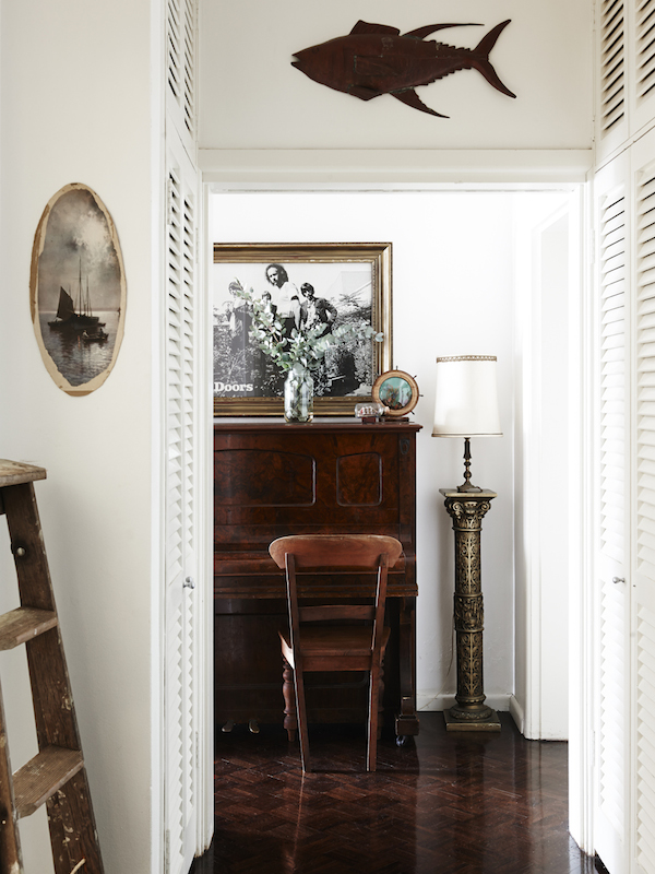 Piano nook. Berlin piano, Doors poster , vintage ladder, copper fish. Photo – Eve Wilson. Production – Lucy Feagins/The Design Files.