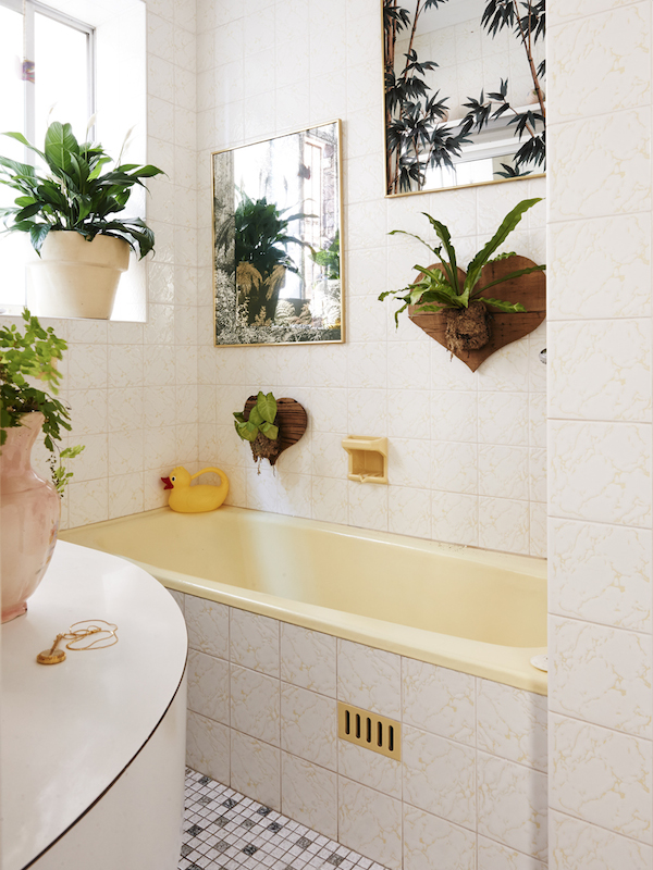 Sweet leafy Bathroom! Vintage mirrors and timber hearts with mounted plants made by Dion. Photo – Eve Wilson. Production – Lucy Feagins/The Design Files.