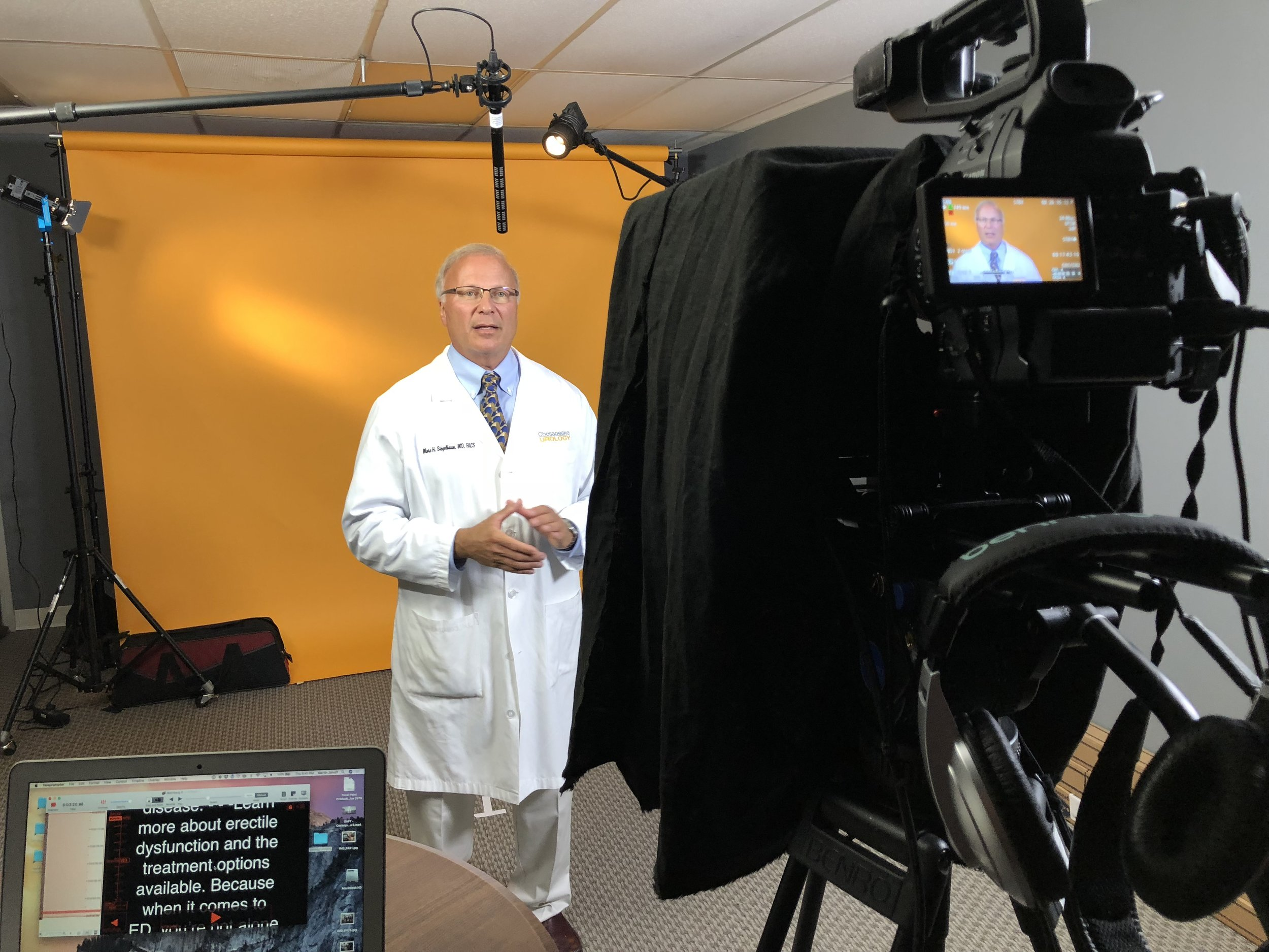 Dr. Marc H Siegelbaum in studio recording a promotional video.