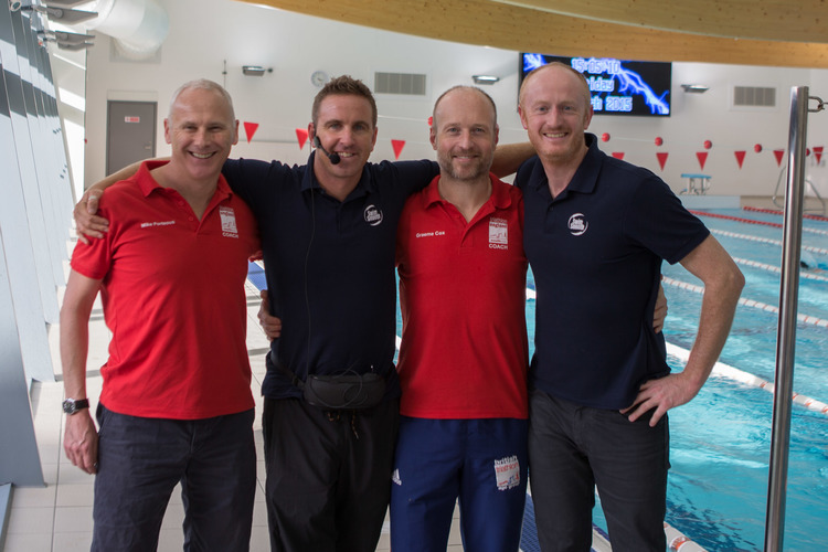 In the blue, Paul Newsome and Adam Young and in the red Bri Tri coaches Mike and Graeme