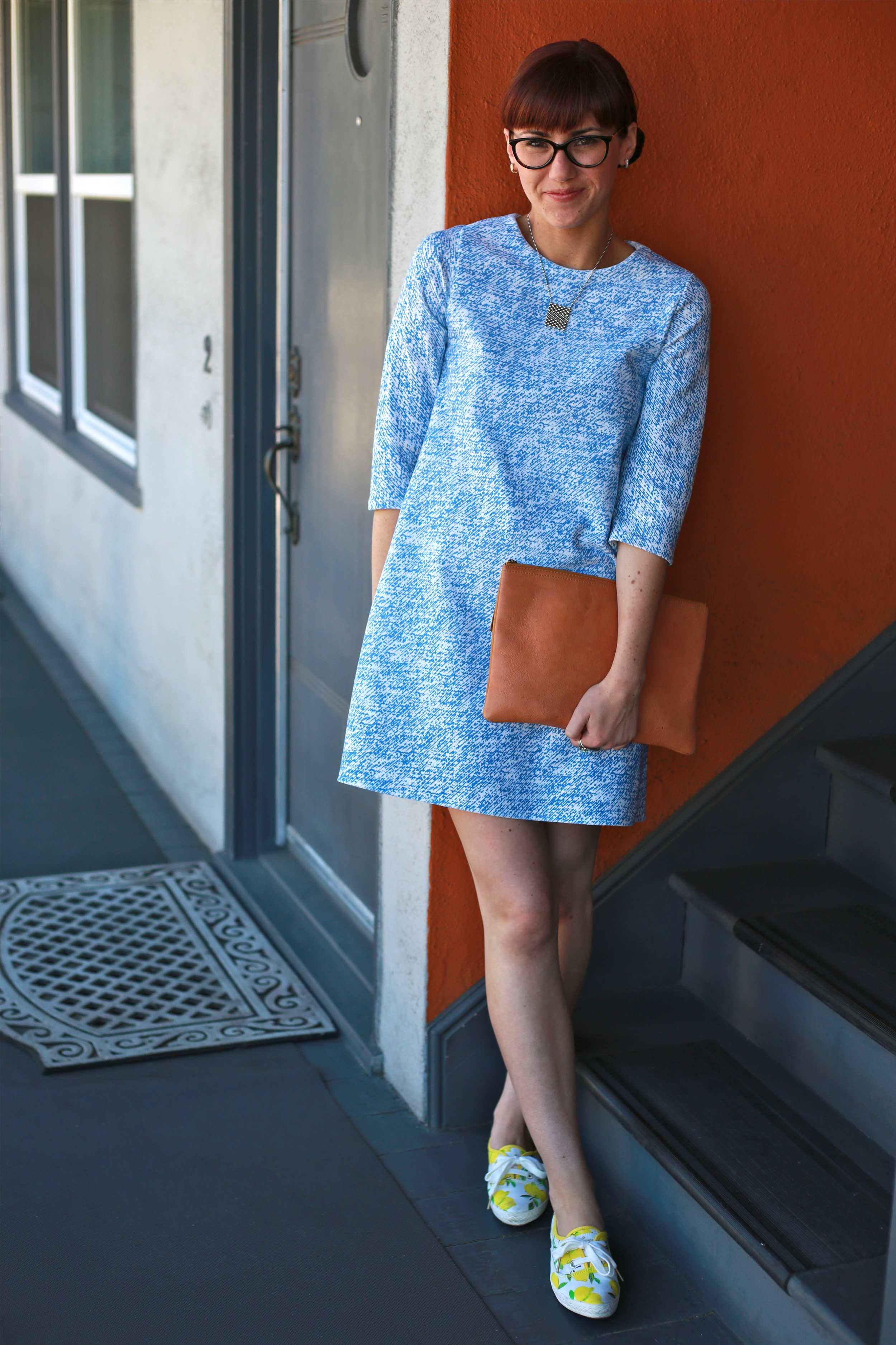 Dress: Zara; Clutch: Madewell; Sneakers: Kate Spade x Keds; Rings: Vintage; Glasses: Prada