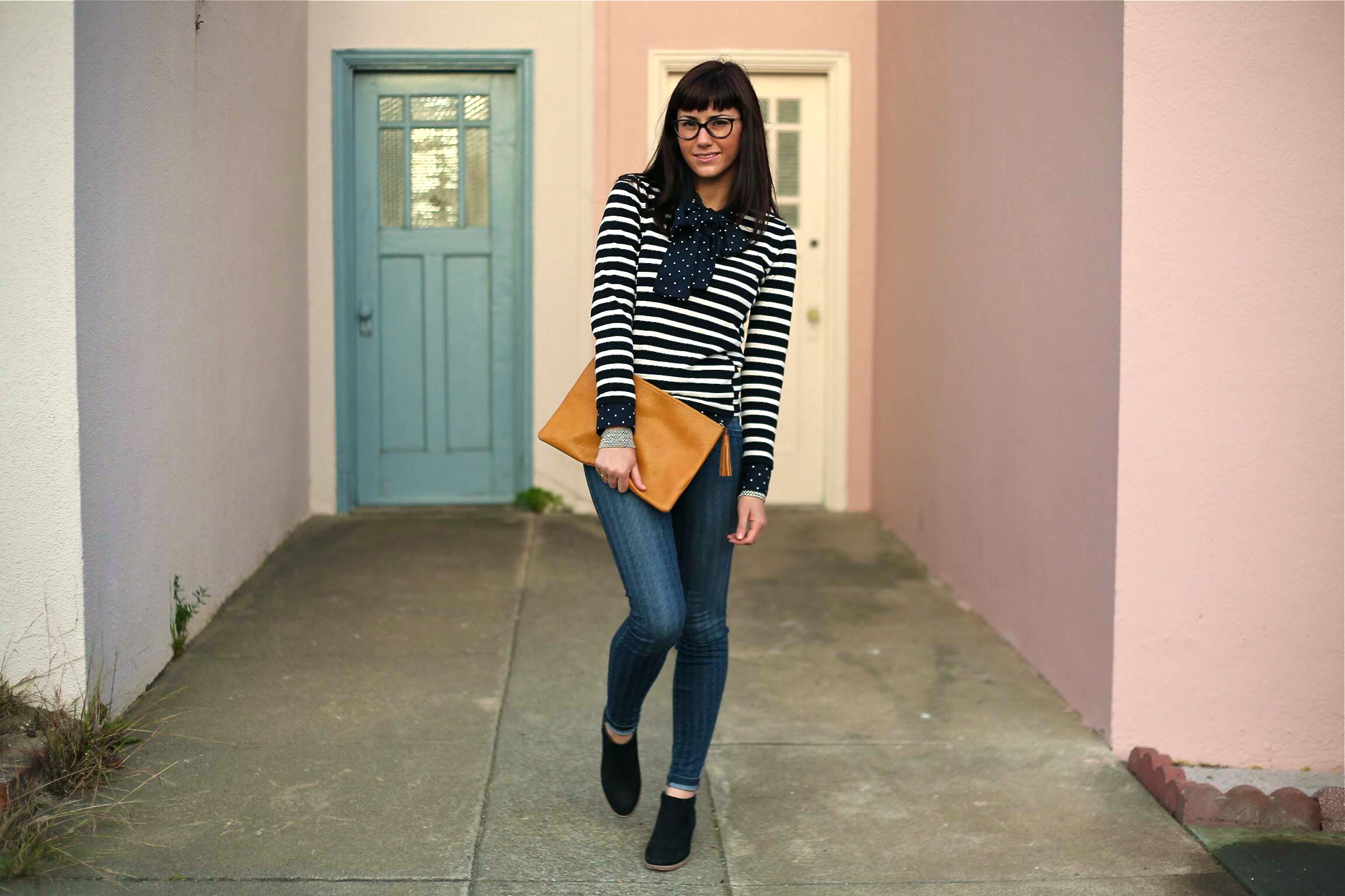 Bow Blouse (Old): Uniqlo, Shop New  Here ; Stripe Sweater: J.Crew; Jeans: Level 99, Anthropology;  Boots: Jigsaw London ; Clutch: Madewell