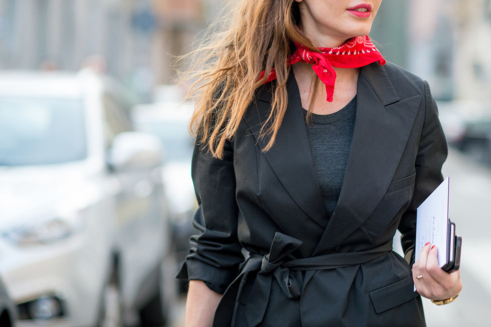 Jazz up an all black outfit with a colorful neck scarf