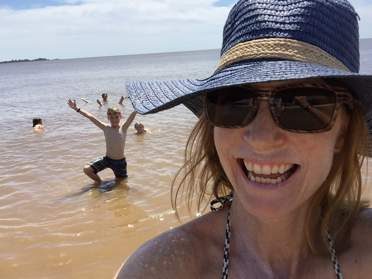 Swimming in the Rio de la Plata off the coast of Colonia del Sacramento, Uruguay