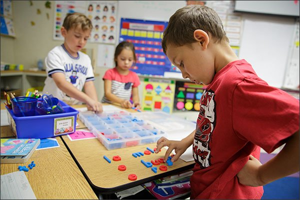 First grader Aston Prieto, 6, uses magnetic letters to form words in Italian at the Franklin International Language Academy in Glendale, Calif. The district, home to seven dual-language-immersion elementary schools, was the first to recognize its graduates for achieving biliteracy. California later adopted a statewide Seal of Biliteracy, the first state to do so.  —Emile Wamsteker for Education Week