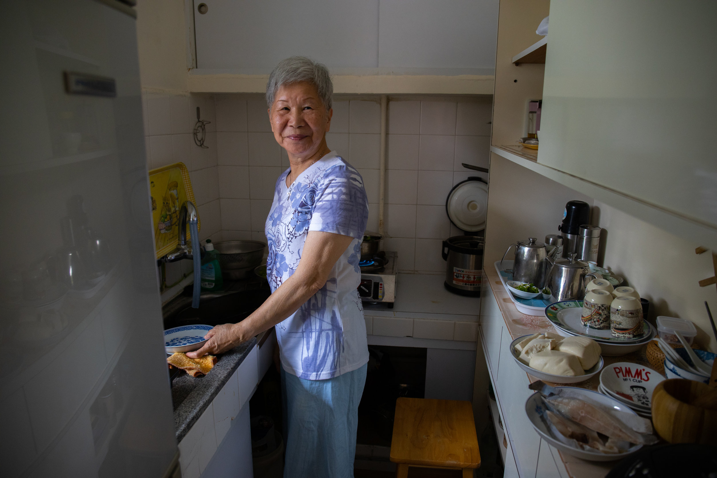 Madame Leung in her kitchen, Hong Kong, June 2019