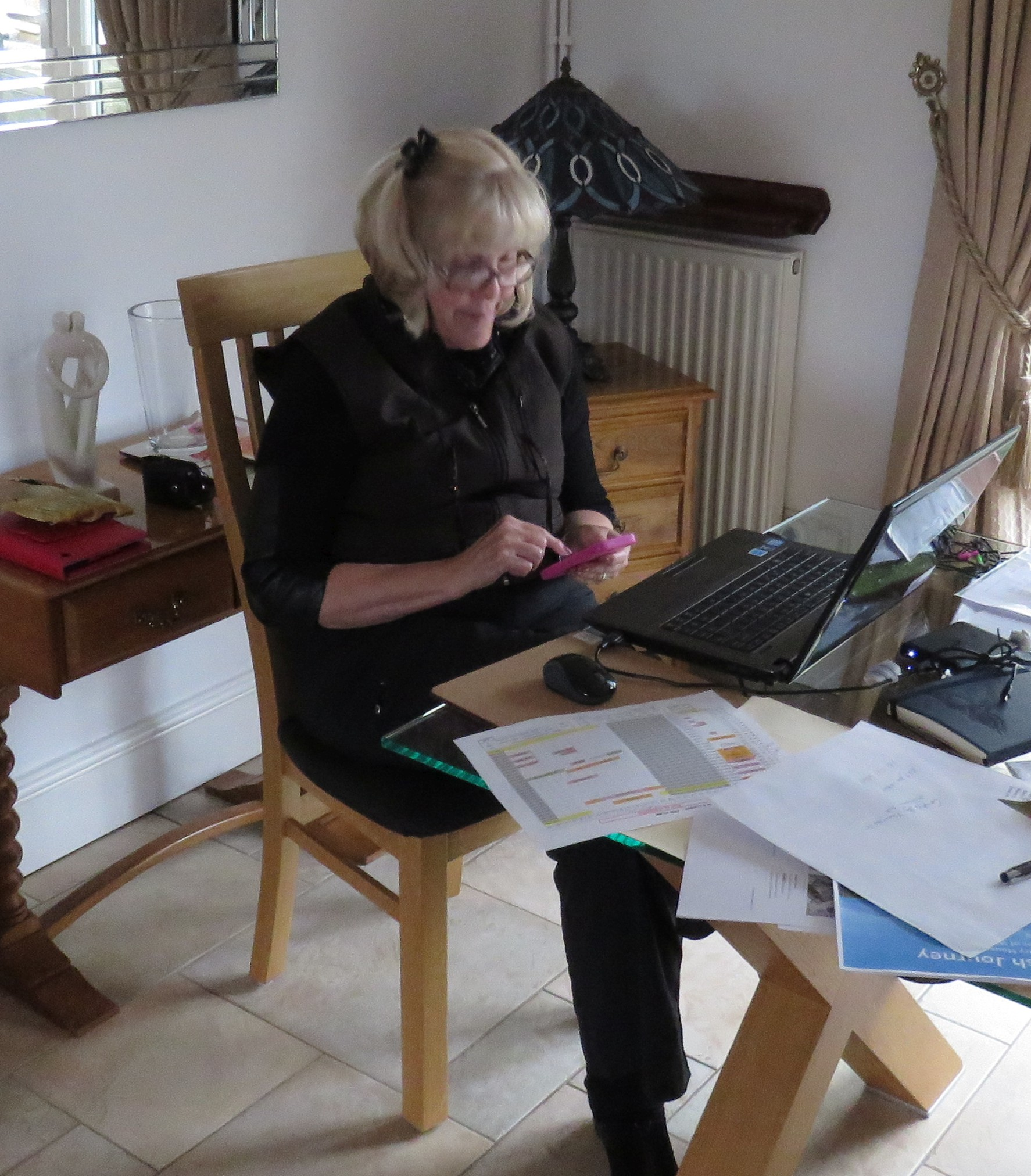 Ann deep in computer and iPhone