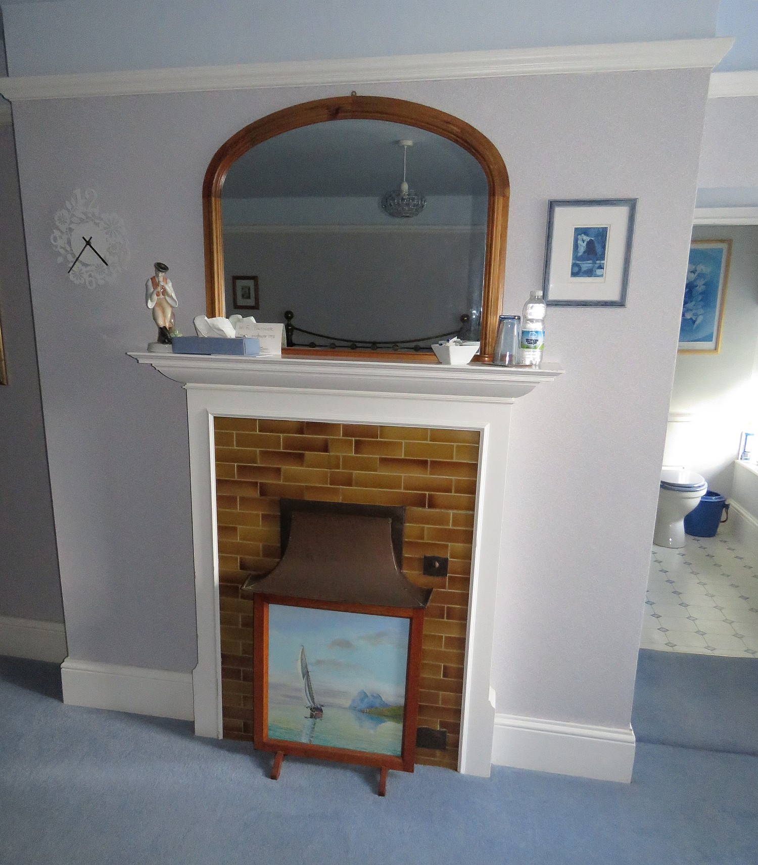 Norah's fireplace with a peek into her loo