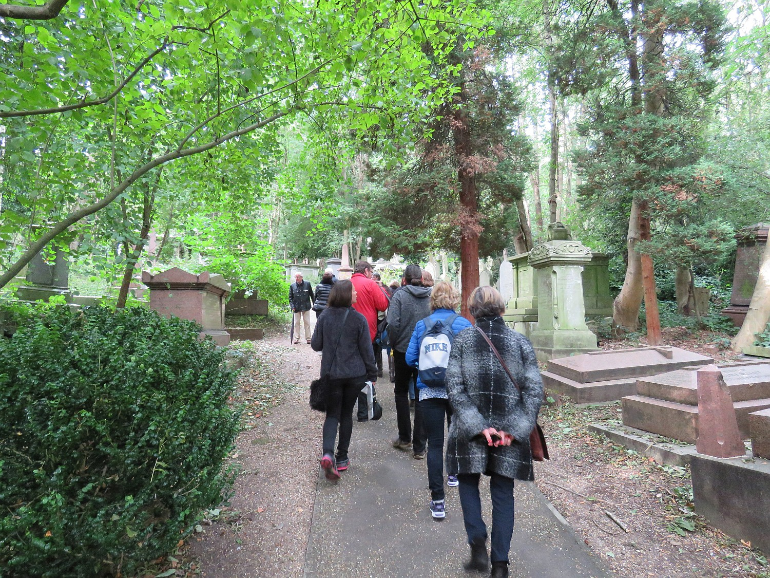 Walking down typical path between graves.  They stretch many ranks back from the path.