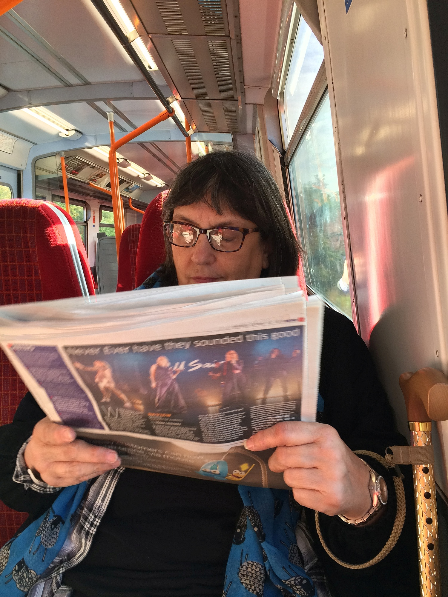 Norah enjoying the free newspaper they give our morning and evening at all transport stops. A different paper each morning and evening. Print media still has lots of legs in the UK.