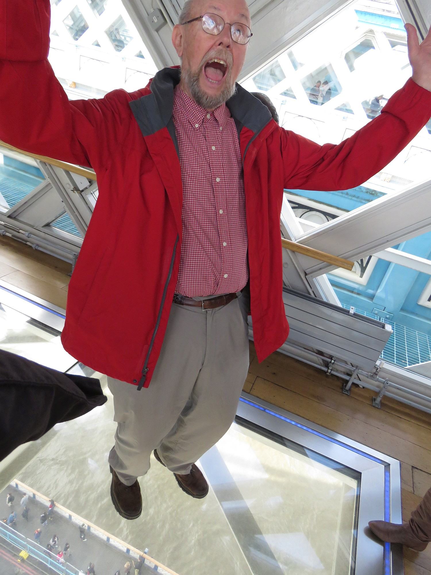 Ed standing on the glass floor of the pedestrian overpass on Tower Bridge.