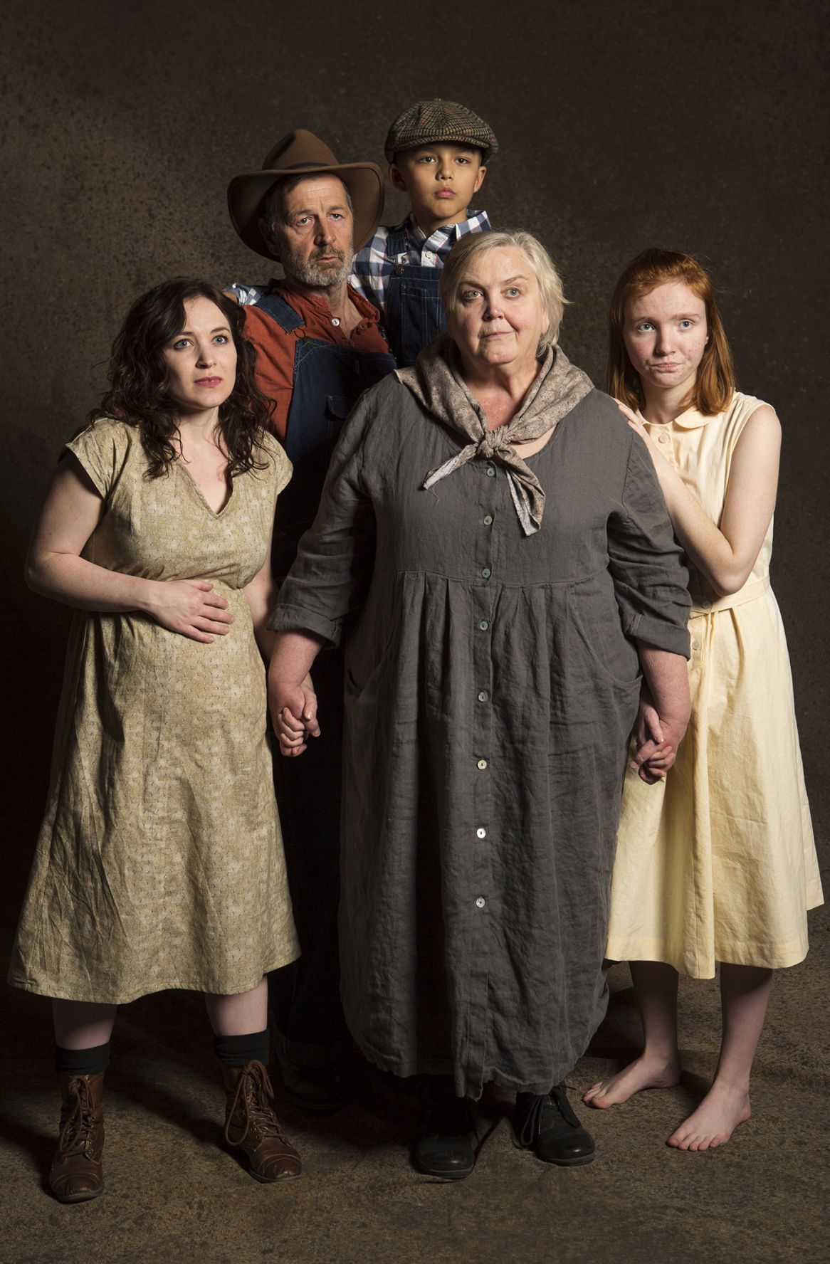 Part of the Joad Family:  Bryn Booth as Rose of Sharon, David Greenwood as Pa Joad, Gabriel Morales as Winfield, Cynthia Meier as Ma Joad, Florie Rush as Ruthie.  Photo AZ Daily Star.