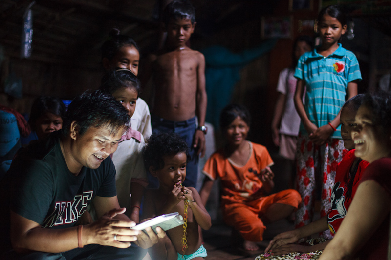 Phearom uses a low-end Samsung tablet to enter the names and details of the new Alongsiders and their little brothers and sisters in an Android app. Each participant is photographed. This information is then uploaded to an online database when he has wifi access.