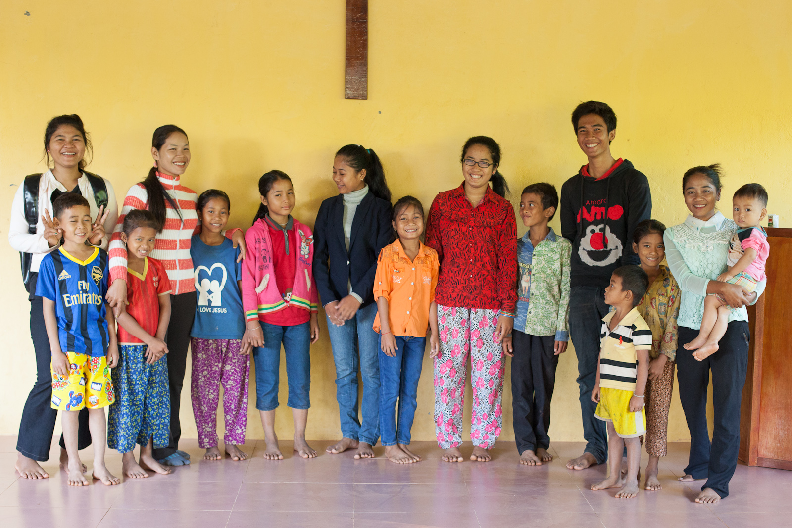 Alongsiderswith their little brothers and sisters anda few extras. Chanthy is wearing orange and white stripes. Piya and her little brother are on the right in yellow.