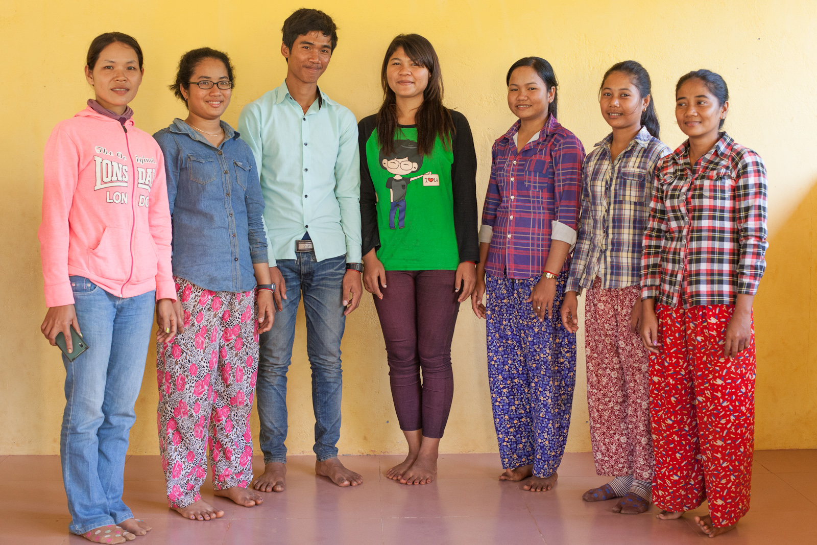 Chanthy, left, with six of the new Alongsiders from her community.