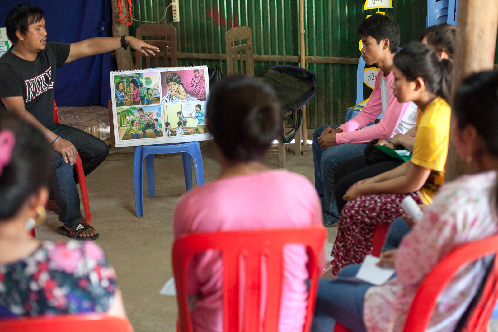 Phearom, Alongsiders Cambodia Coordinator, trains Alongsiders in Kandal Province to respond to child protection issues.