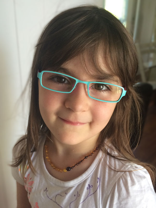 I had the children's eyes tested recently because I had noticed that Lily was leaning close to the computer screen when she was doing her lessons or playing games. It seems she has trouble focusing and needs a little help during her lessons and on the computer. She was so excited to choose these glasses and has no trouble remembering to put them on when she needs them. Is it just me or is she just amazingly beautiful?