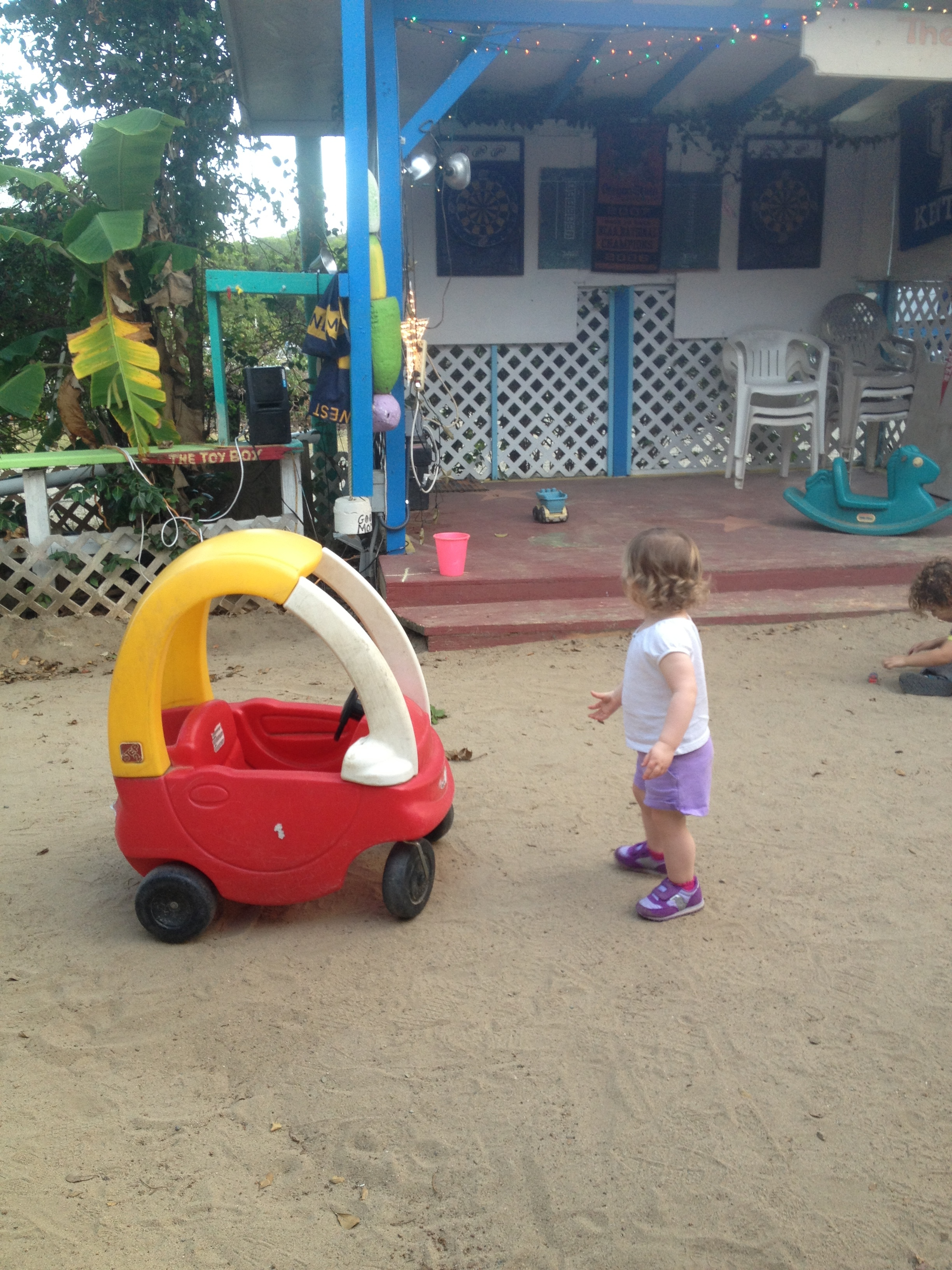 Elenor admires the Cozy Coupe at Skinny Legs.