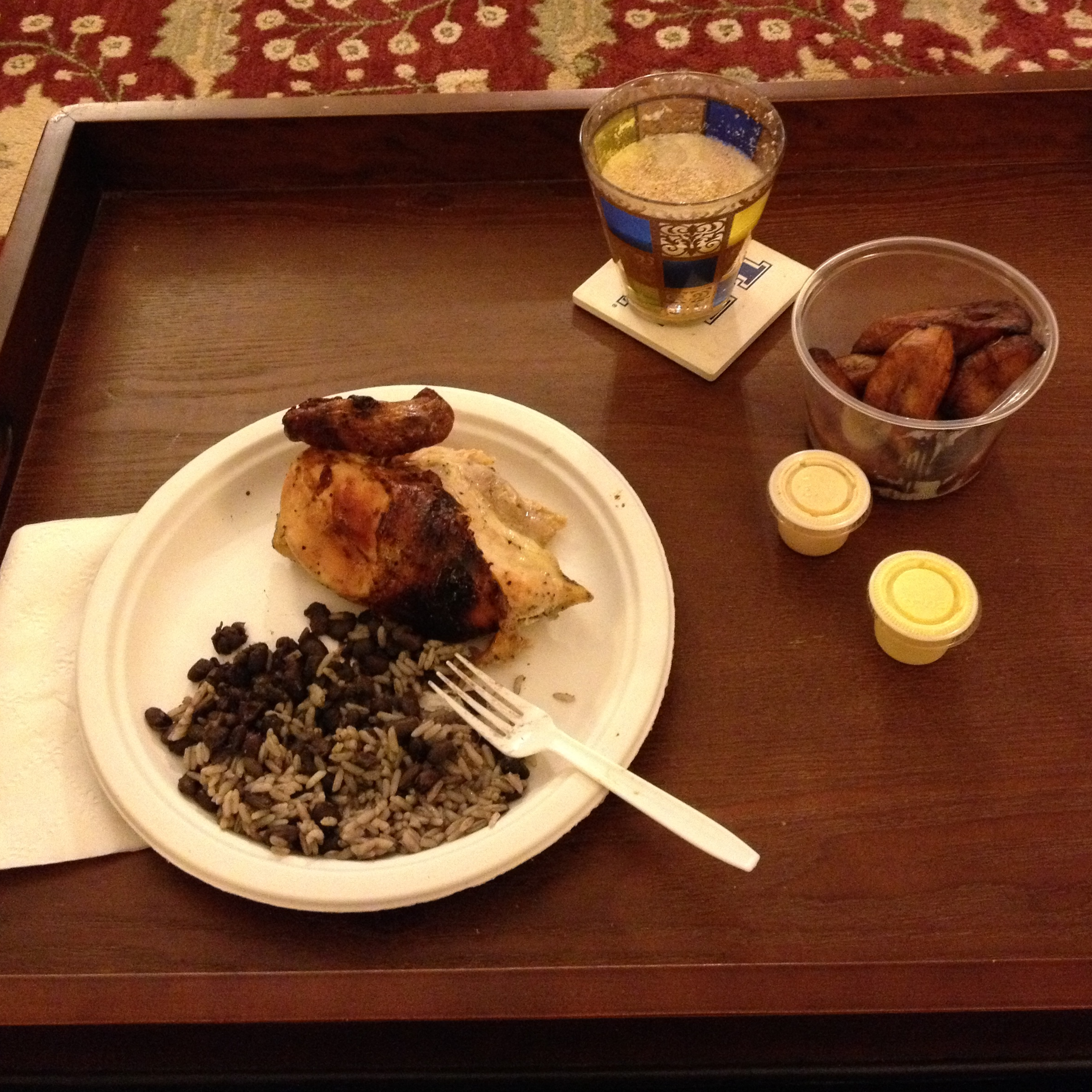 A painkiller enlivens an elegant meal of take-out Peruvian chicken with rice, beans, and fried plantains.