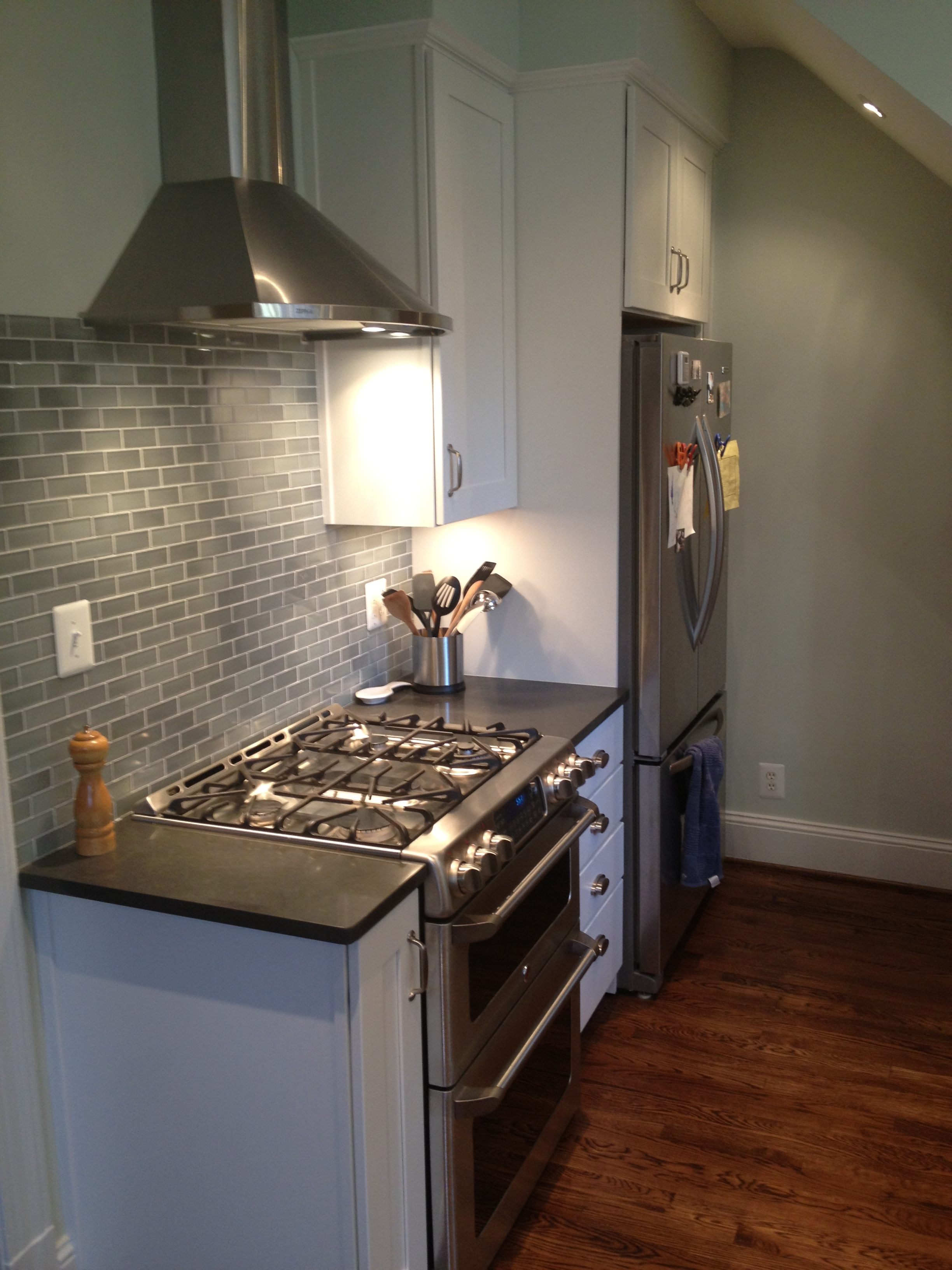 New range with hood and french-door refrigerator