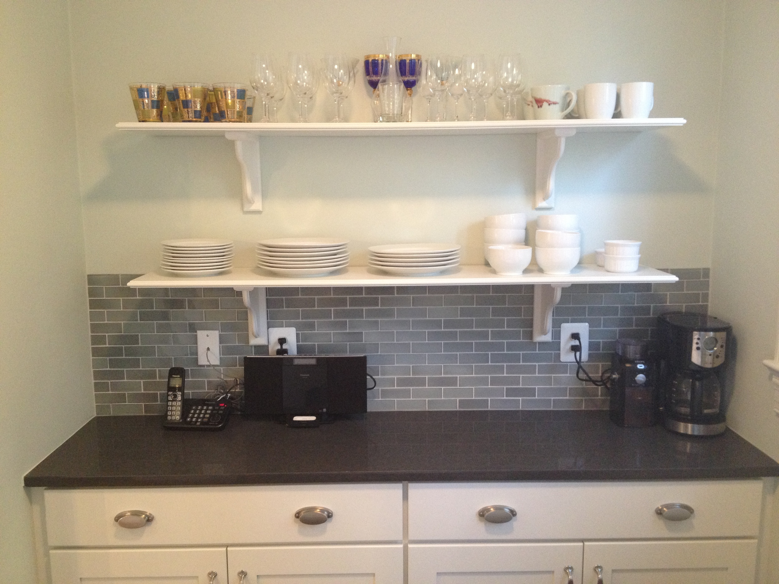 We added shallow lower cabinets, a strip of countertop, and open shelves to the wall of the eating area