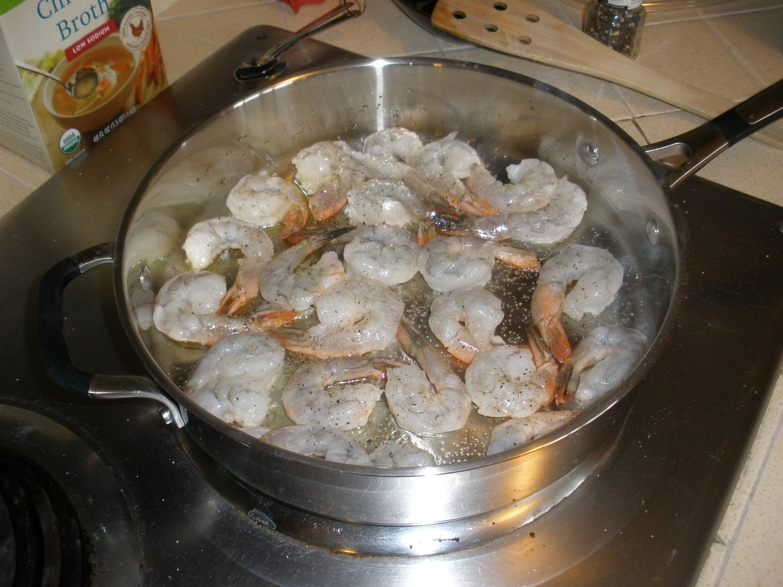 Step two: Salt and pepper shrimp, then cook in batches and set aside.