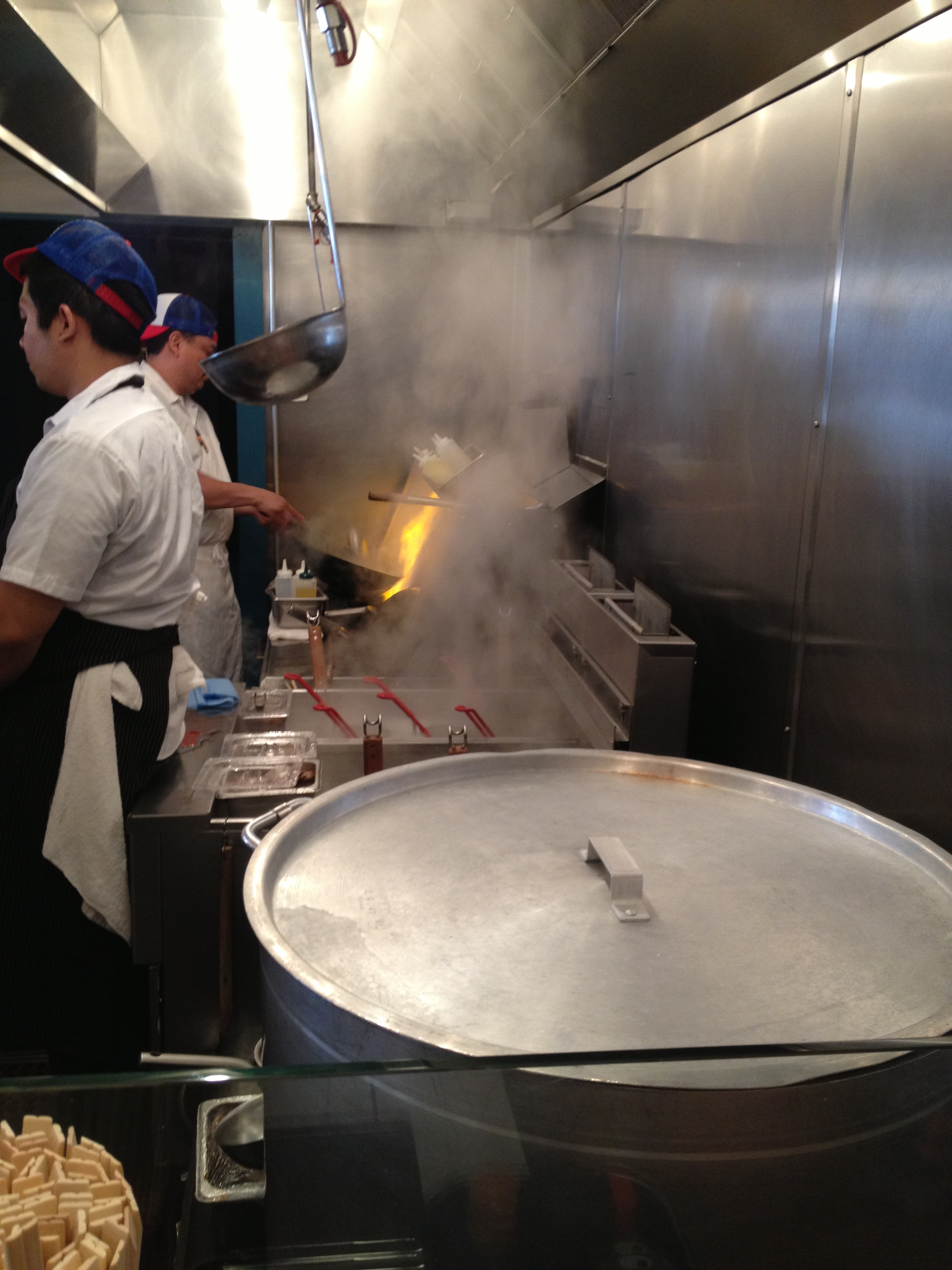 The ramen chefs in action