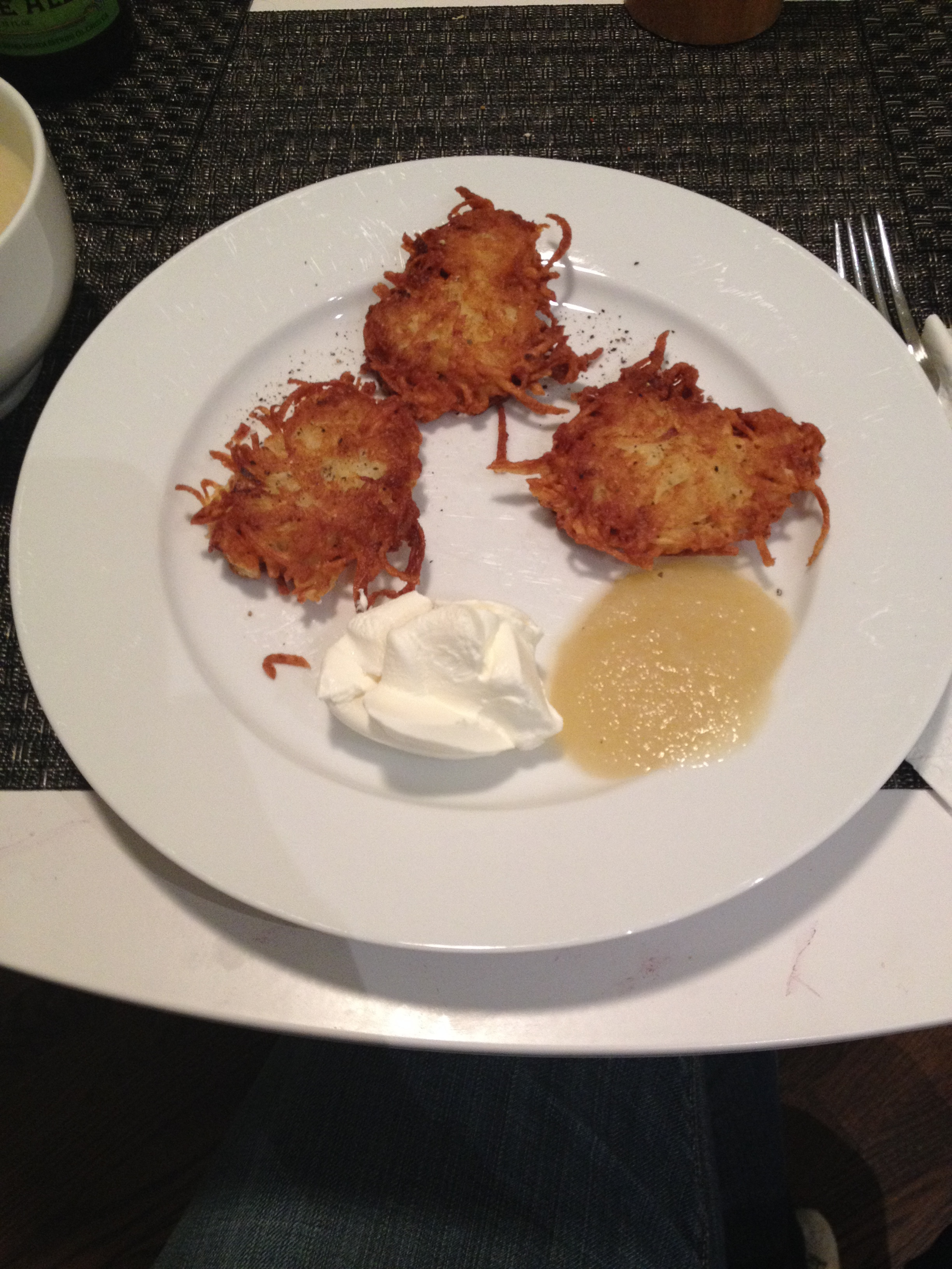 Homemade latkes with sour cream and applesauce