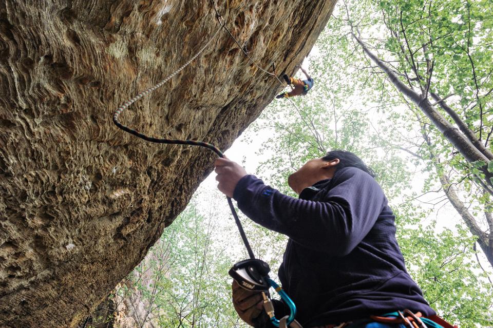 Jon on the belay while Jordan climbs Stay the Hand 5.12a
