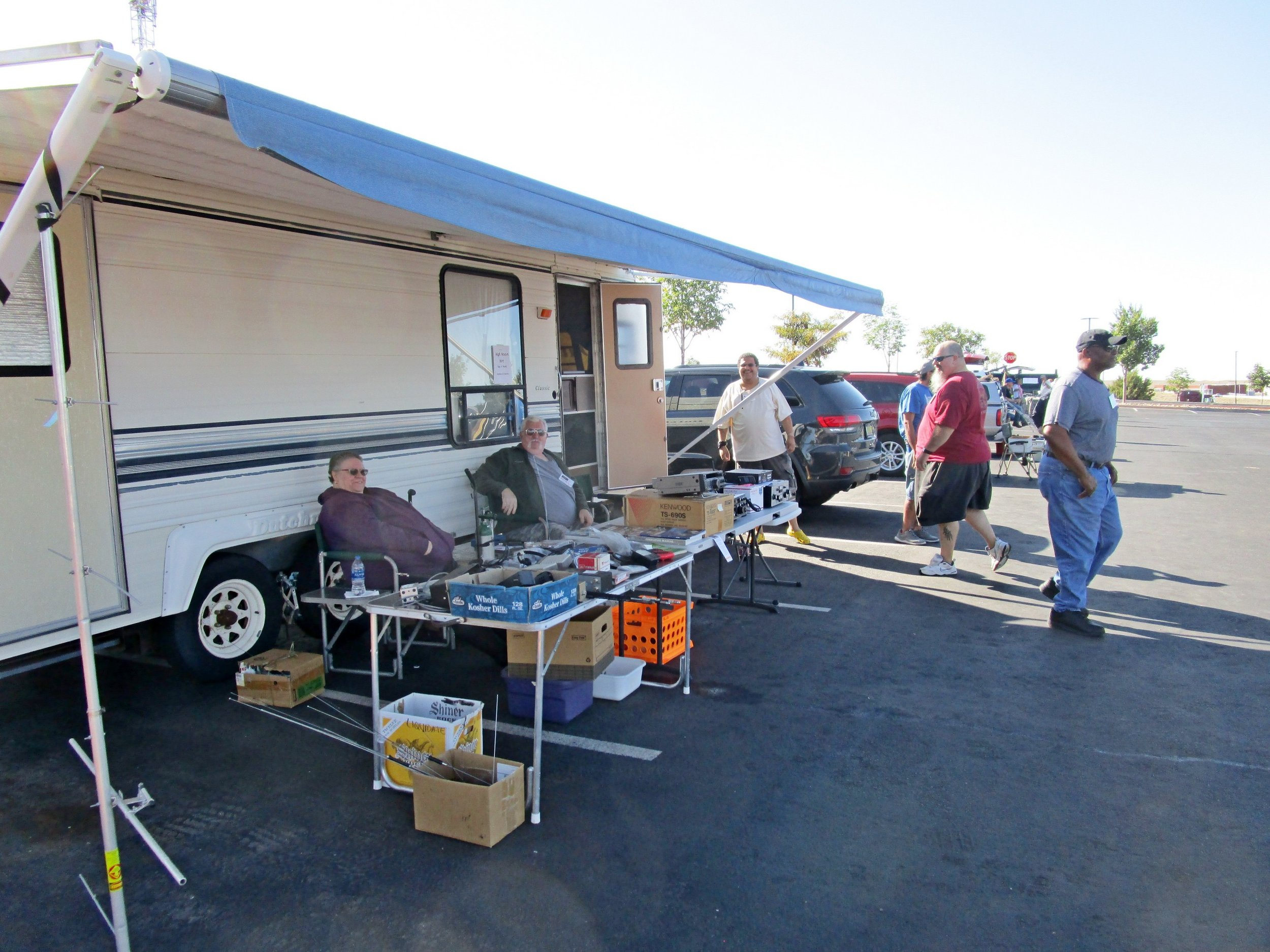 Bruce NK5W and wife's setup at the outdoor flea market.  Looks comfy!