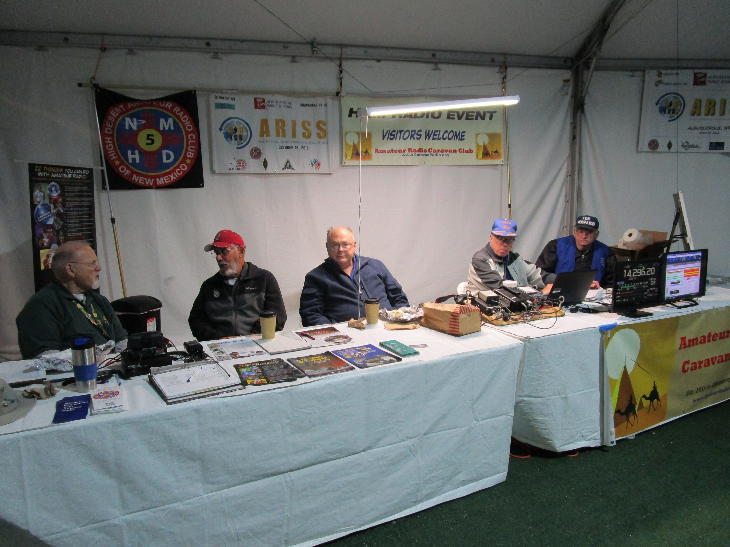 Our booth with a full staff on Wednesday.