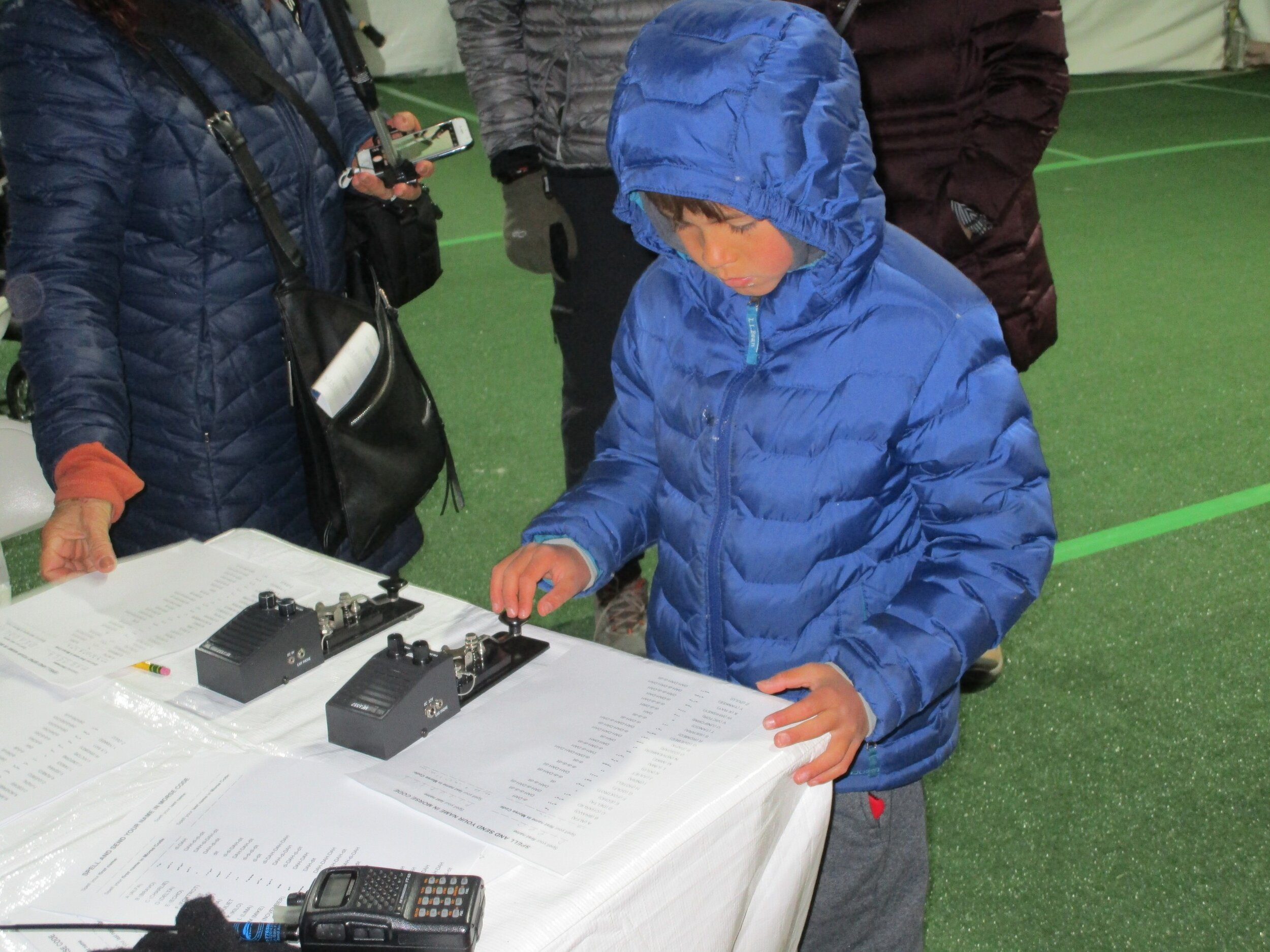 A young man tapping out his name in Morse Code.