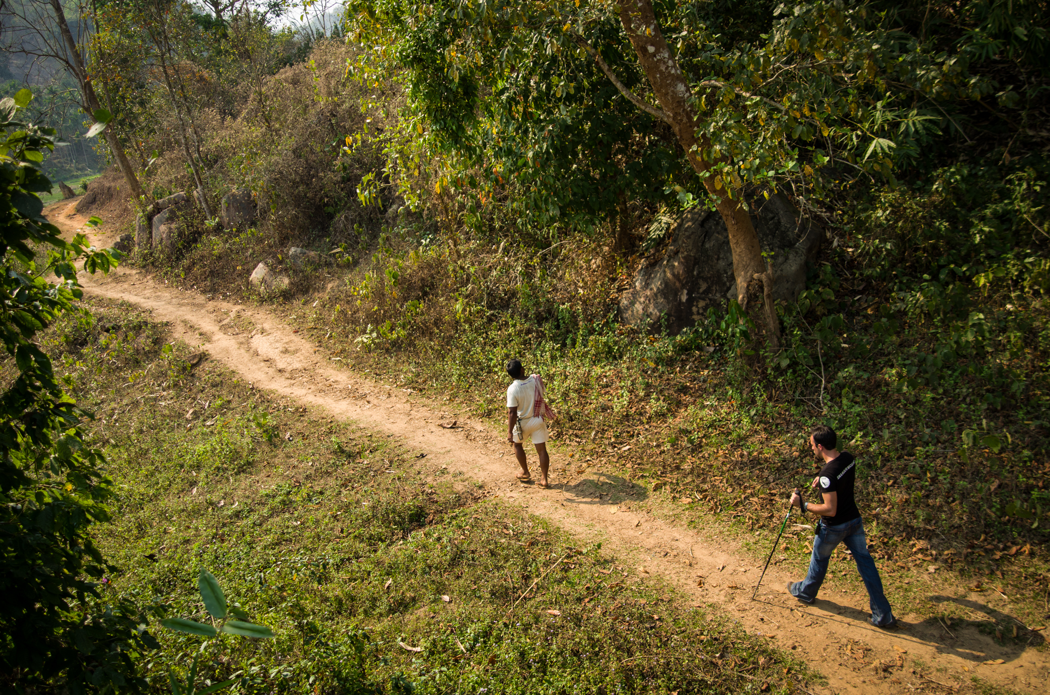 Balram Rasha (in white), a local tribesman from Zaramukhuriya, leads Florian through new land in Chandubi, Assam.