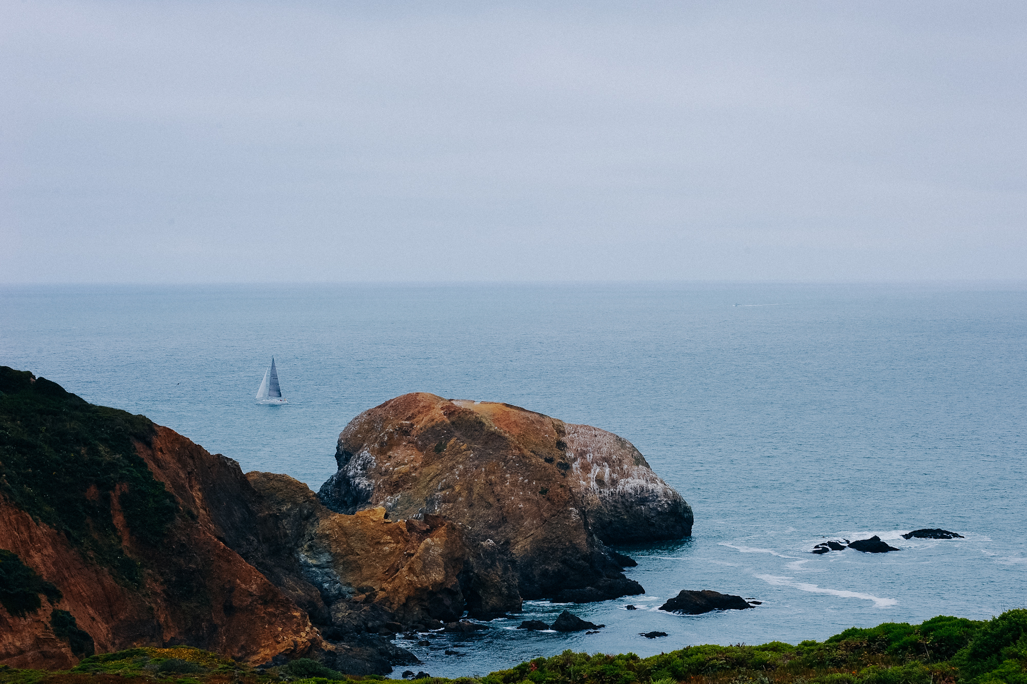 As I was walking down to the cove, I caught a sailboat passing through a dip in the rocks.