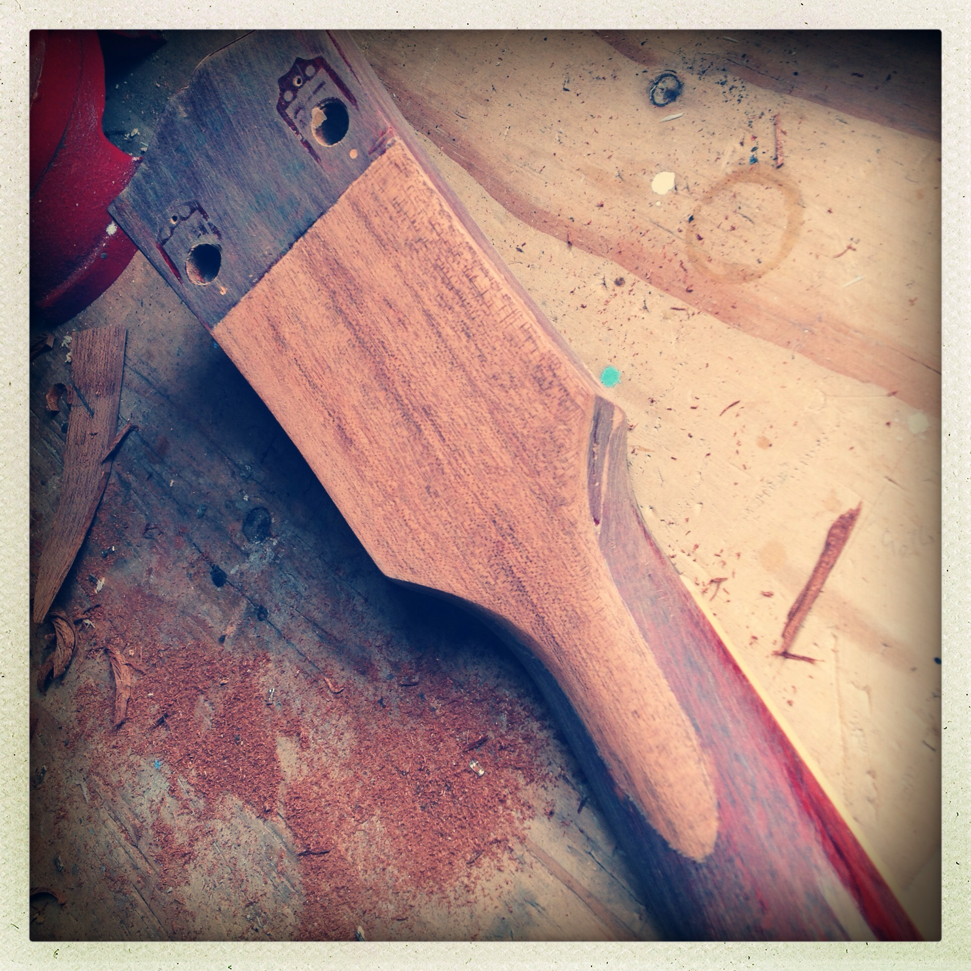 Newly inlaid wood cut to shape on headstock