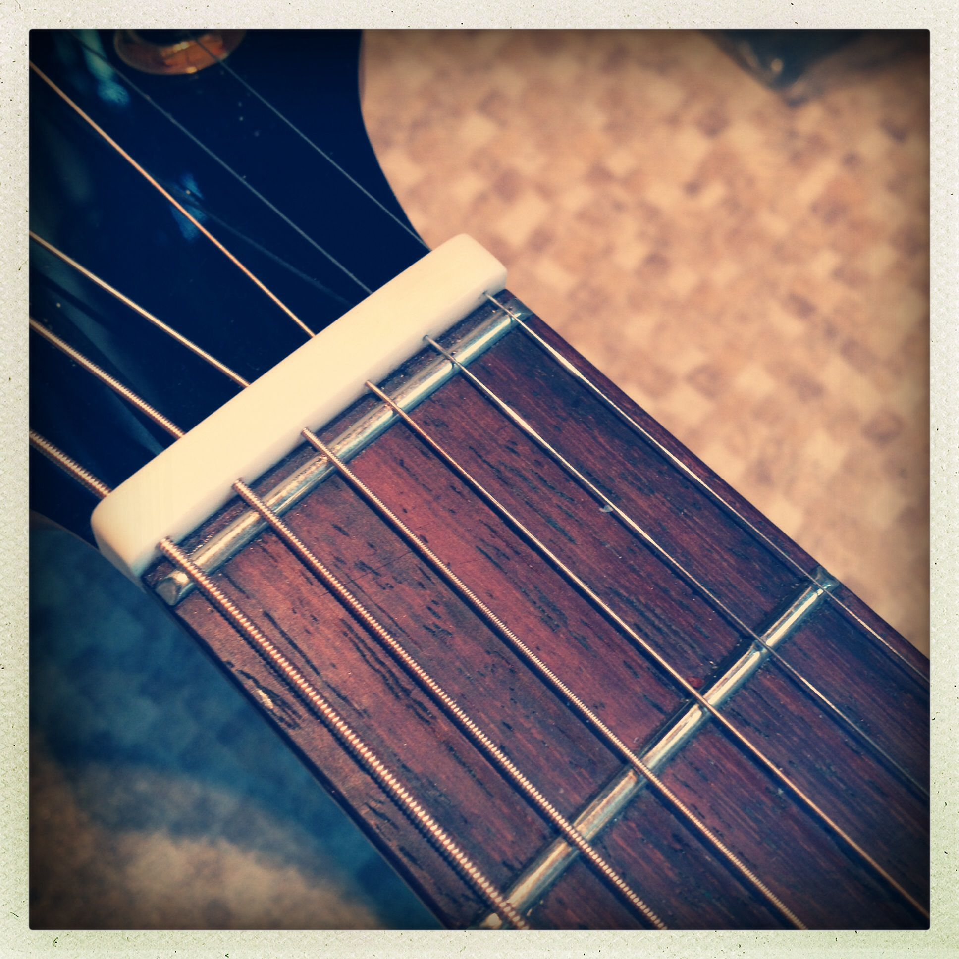 Zero fret on guitar (note: the nut here is a 'captive' nut and holds the strings in holes rather than slots—this is relatively unusual and for a particular application)