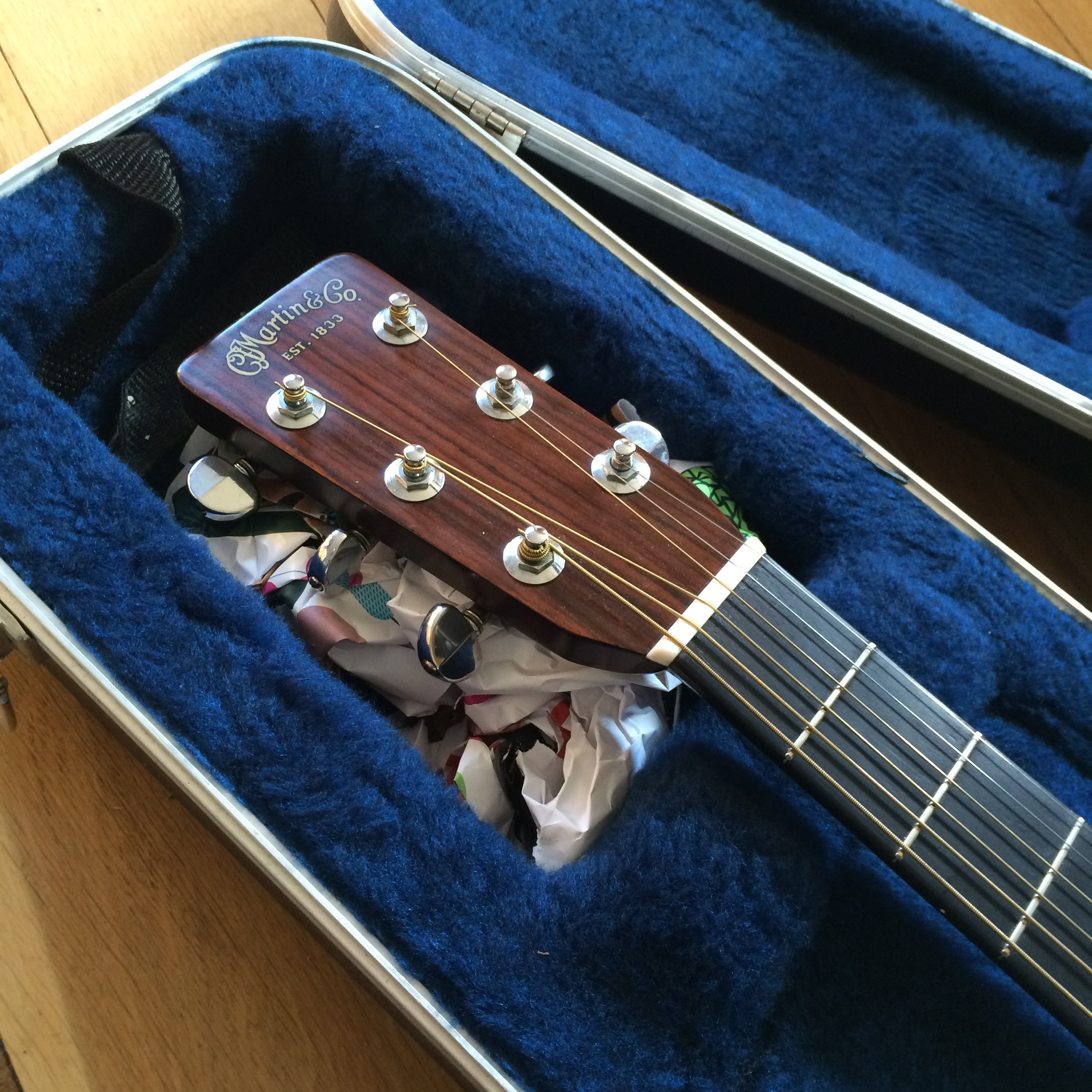 Crumpled paper under the headstock helps prevent broken necks. You want most support as shown.