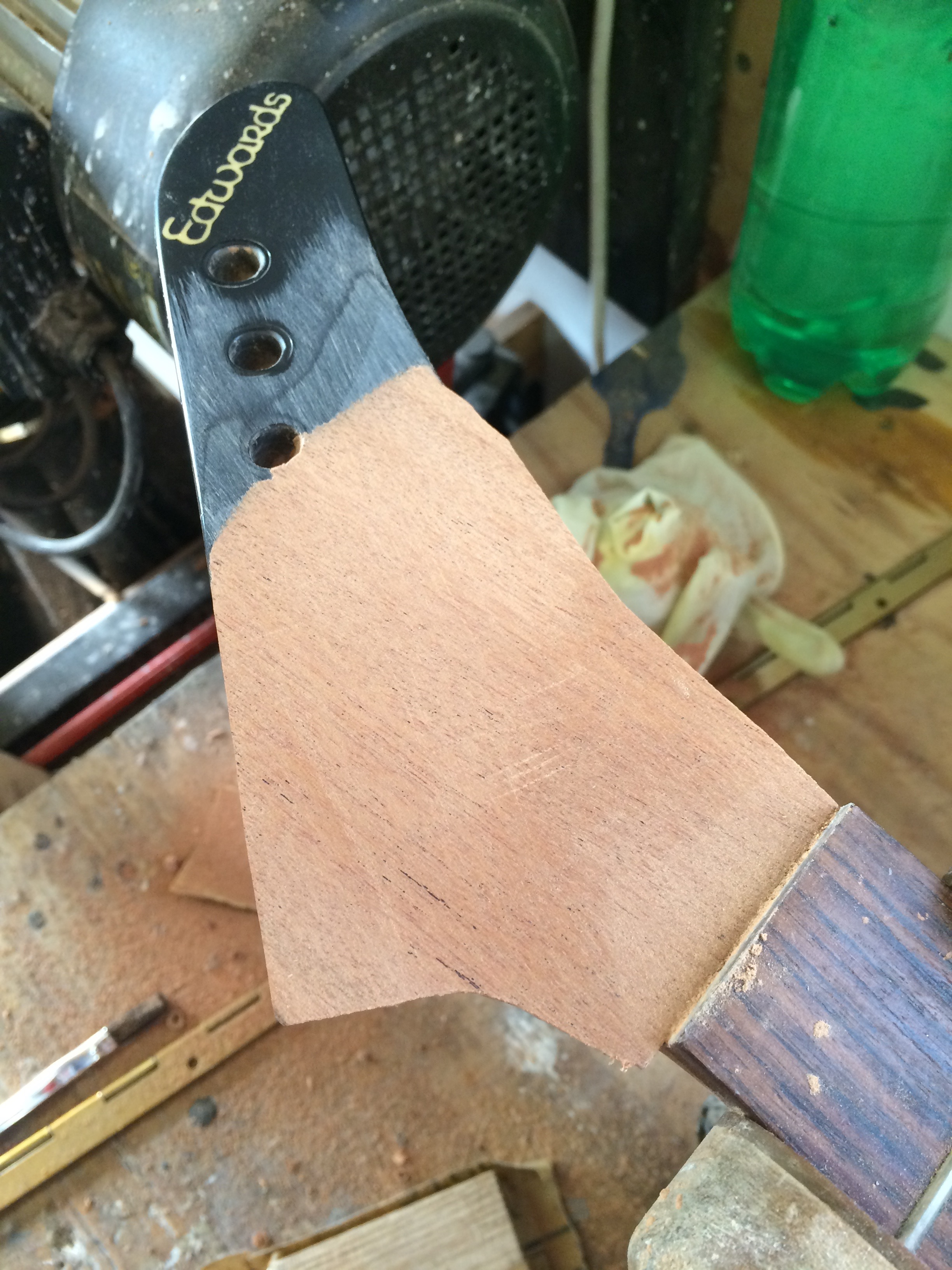 Partial overlay on front of broken headstock (untrimmed)
