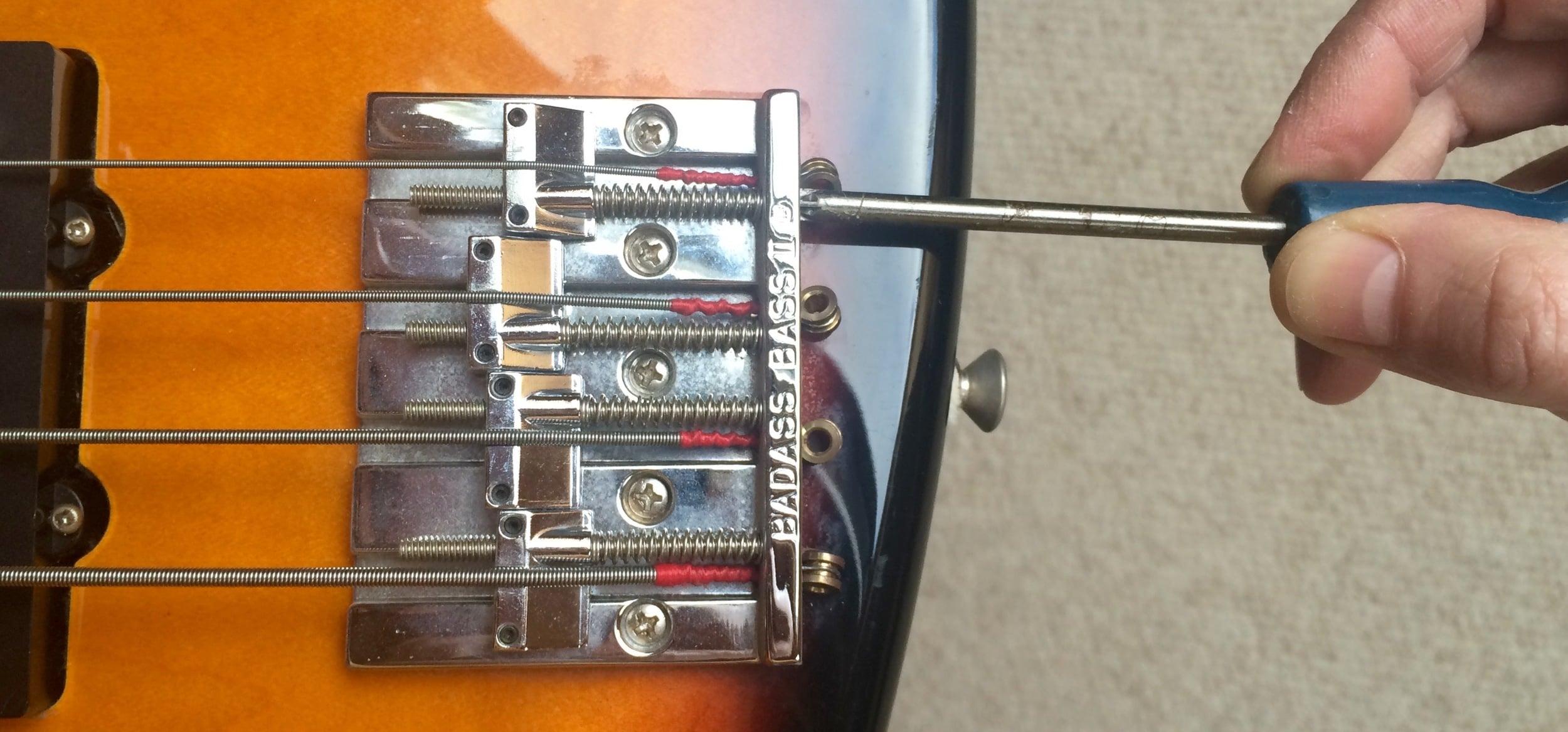 Setting intonation on a bass guitar bridge (a BadAss in this case)