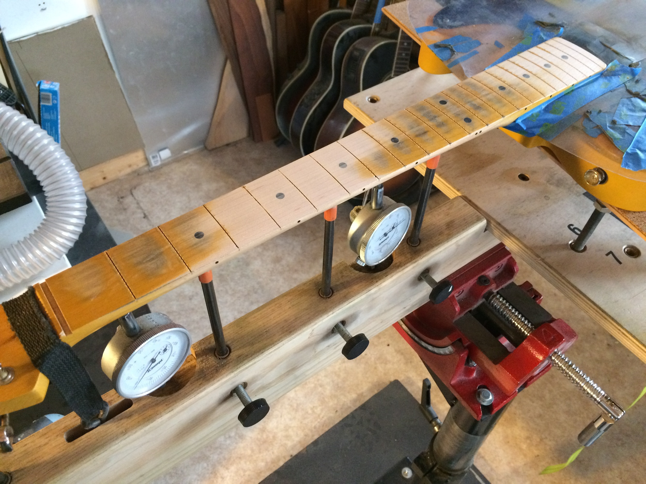 Levelling the fingerboard during refret to address an S-Shaped neck.